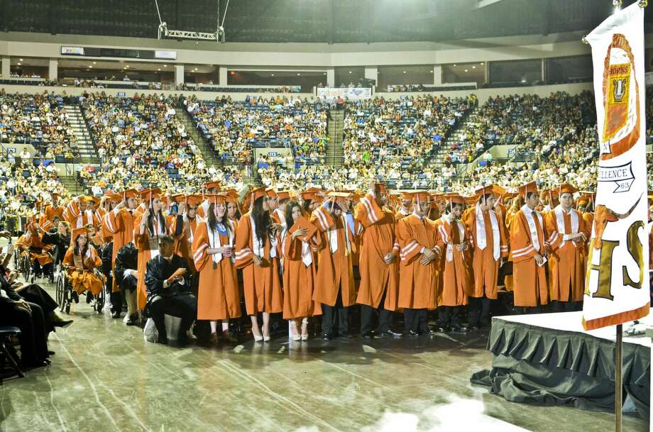 United High School graduates stand in the center of the Laredo Energy Arena as they prepare to make their way to the stage to accept their diplomas Saturday, June 2, 2012. (Danny Zaragoza, File/Laredo Morning Times)