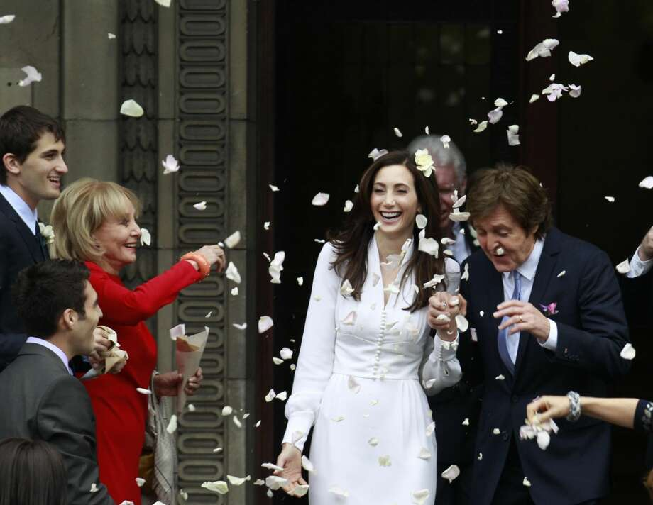 Former Beatle Sir Paul McCartney and his wife American heiress Nancy Shevell leave Marylebone Registry Office, following their wedding in central London, on Sunday. Shevell, 51, is McCartney's third wife.(AP Photo/Lefteris Pitarakis)