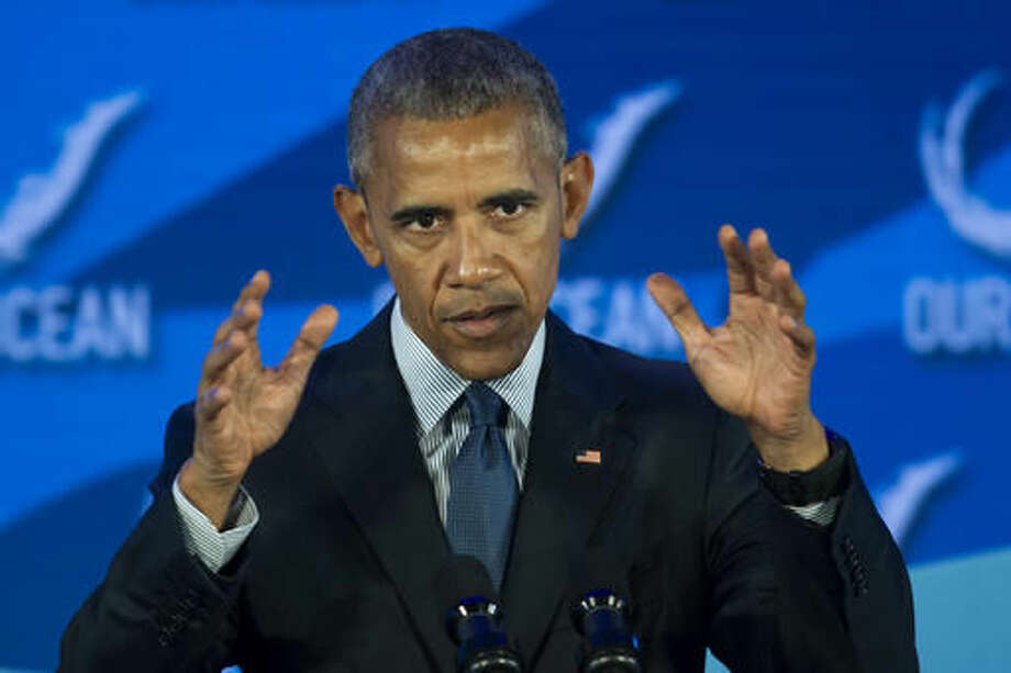 President Barack Obama gestures while speaking at the Our Ocean, One Future conference at the State Department in Washington, Thursday, Sept. 15, 2016. The conferences focus on marine protected areas, sustainable fisheries, marine pollution, and climate-related impacts on the ocean. (AP Photo/Cliff Owen)