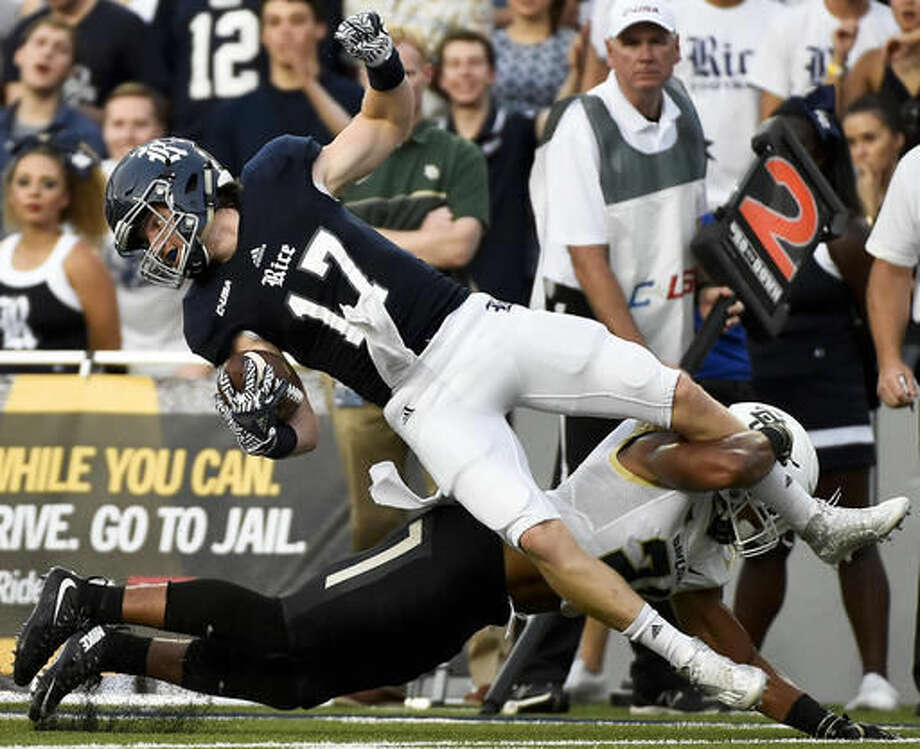 Rice wide receiver Zach Wright (17) is tackled by Baylor defensive back Patrick Levels in the first half of an NCAA college football game, Friday, Sept. 16, 2016, in Houston. (AP Photo/Eric Christian Smith)