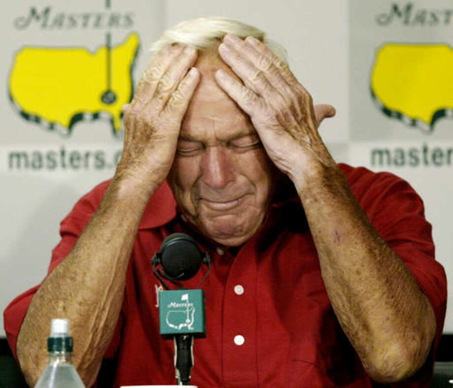 "File-This April 9, 2004, file photo shows four-time Masters champion Arnold Palmer reacting during his press conference after playing his final round of Masters competition at the 2004 Masters golf tournament at the Augusta National Golf Club in Augusta, Ga. Palmer, who made golf popular for the masses with his hard-charging style, incomparable charisma and a personal touch that made him known throughout the golf world as ""The King,"" died Sunday, Sept. 25, 2016, in Pittsburgh. He was 87. (AP Photo/Amy Sancetta, File)"