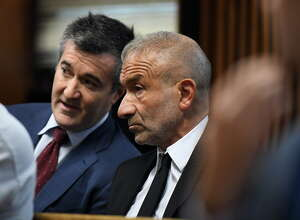 SUNY Polytechnic Institute Founding President and CEO Alain Kaloyeros speaks with his attorney while awaiting his arraignment on state charges while sitting in a courtroom at Albany City Courthouse on Friday morning, Sept. 23, 2016, in Albany, N.Y. (Will Waldron/Times Union)