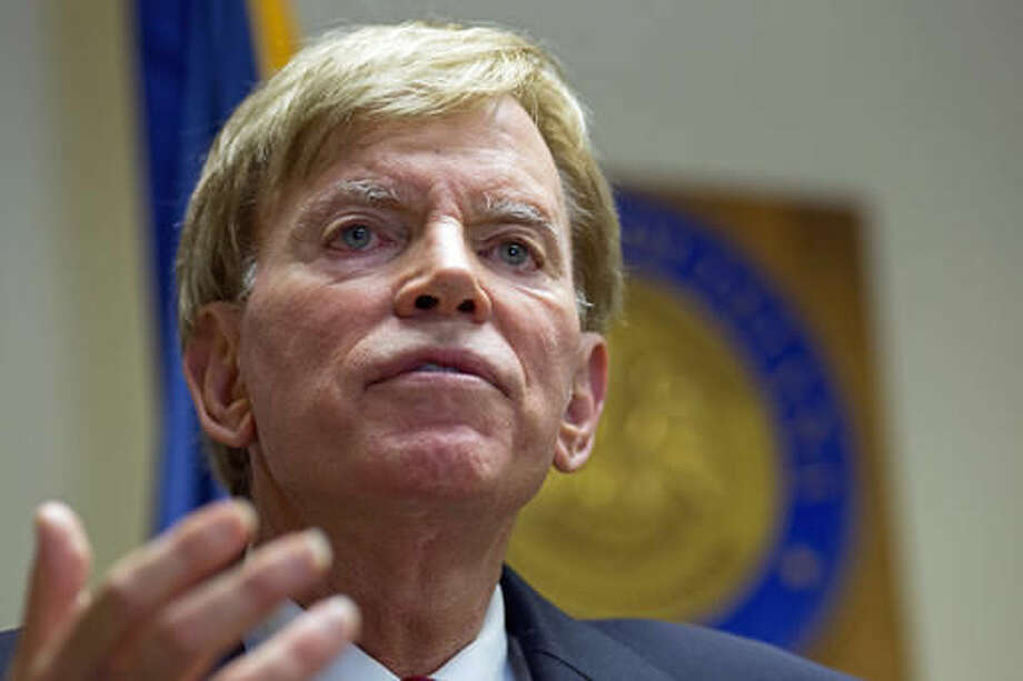 """In this July 22, 2016 file photo, former Ku Klux Klan leader David Duke talks to the media at the Louisiana Secretary of State's office in Baton Rouge, La. A war of words over Donald Trump's """"deplorables"""" is intensifying as Republicans and Democrats fight to score political points over Hillary Clinton's charge that millions of the New York billionaire's supporters are racist, sexist and homophobic. (AP Photo/Max Becherer, File)"""