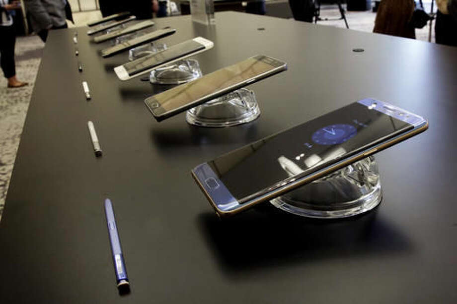 FILE - In this July 28, 2016, file photo, the Galaxy Note 7, foreground, is displayed in New York. U.S. regulators issued an official recall of Samsung's Galaxy Note 7 phone on Thursday, Sept. 15, 2016, because of a risk of fire. (AP Photo/Richard Drew, File)