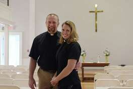 Co-pastors of the Schoharie Reformed Church, Rev. Michael Meyer-Veen and his wife, Rev. Sherri Meyer-Veen, pose for a photo inside the church on Wednesday, Oct. 19, 2016, in Schoharie, N.Y.    (Paul Buckowski / Times Union)