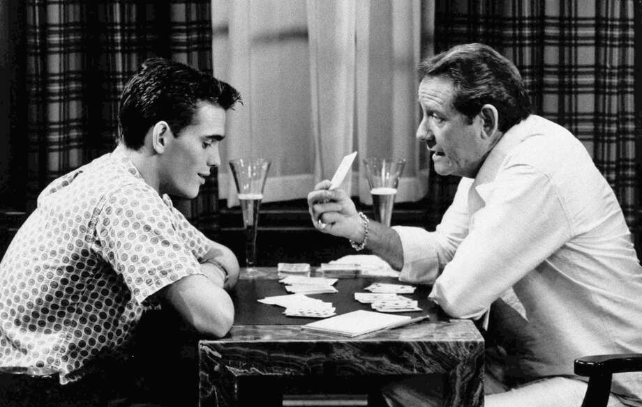 """In this undated file photo, veteran actor Richard Crenna, right, and Matt Dillon play cards in scene from the 1984 film """"The Flamingo Kid."""" (AP Photo/20th Century Fox, File)"""