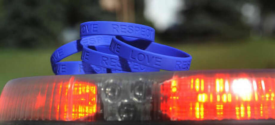 "ADVANCE FOR USE SATURDAY, SEPT. 17 - In this Sept. 12, 2016 photo, blue wristbands with the words ""Give, Love, Respect"" are displayed in Johnstown, Pa. The wristbands were given to the Johnstown police force by an area business, hoping to encourage residents to work together with police. (Todd Berkey/The Tribune-Democrat via AP)"