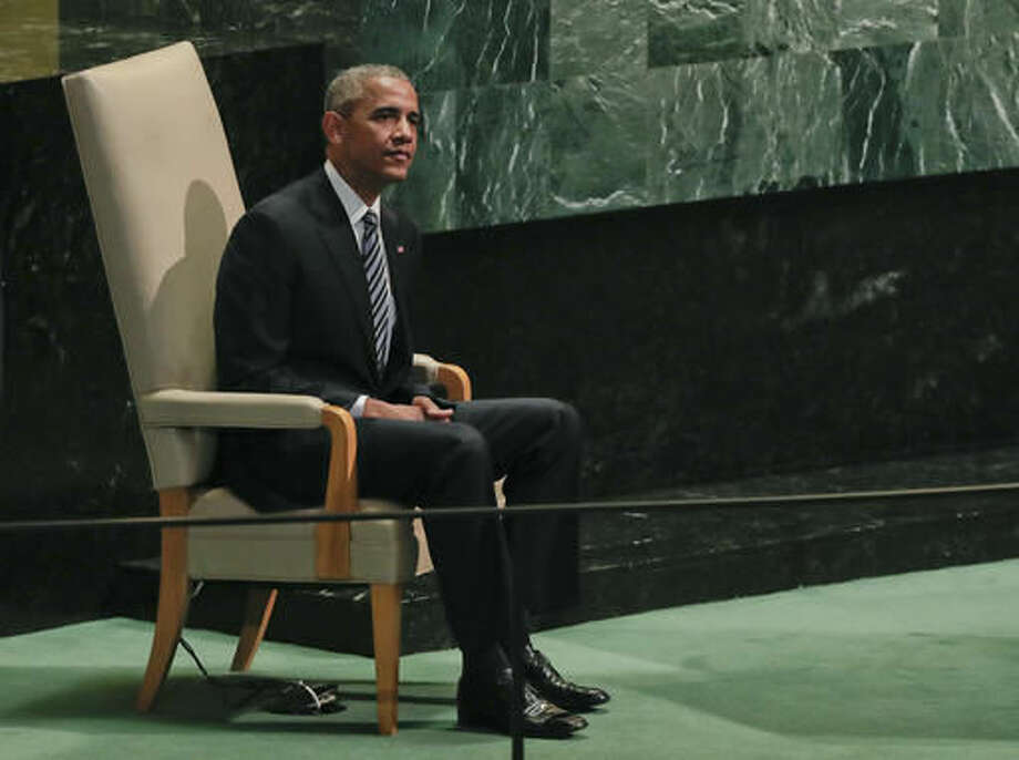 United States President Barack Obama waits in the speaker's chair after speaking at the 71st session of the United Nations General Assembly, Tuesday, Sept. 20, 2016, at U.N. headquarters. (AP Photo/Julie Jacobson)