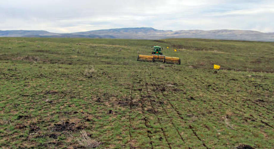 FILE - In this 2015 file photo, provided by the Bureau of Land Management, a rangeland drill reseeds an area burned by the Soda Fire in southwest Idaho. The federal government's 5-year, $67 million rehabilitation effort following a rangeland wildfire in southwest Idaho and southeast Oregon is entering its second year with another round of herbicide applications combined with plantings of native species. (Bureau of Land Management via AP, file)