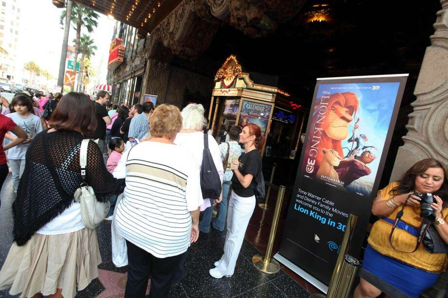 "Guests on Saturday gather outside before a screening of ""The Lion King"" in 3D at The El Capitan Theatre, in Los Angeles. The Disney animated musical earned a surprising $29.3 million in its first weekend in theaters, according to studio estimates Sunday. The original film made more than $40 million when it opened nationwide 17 years ago. (AP Photo/Time Warner Cable, Casey Rodgers)"