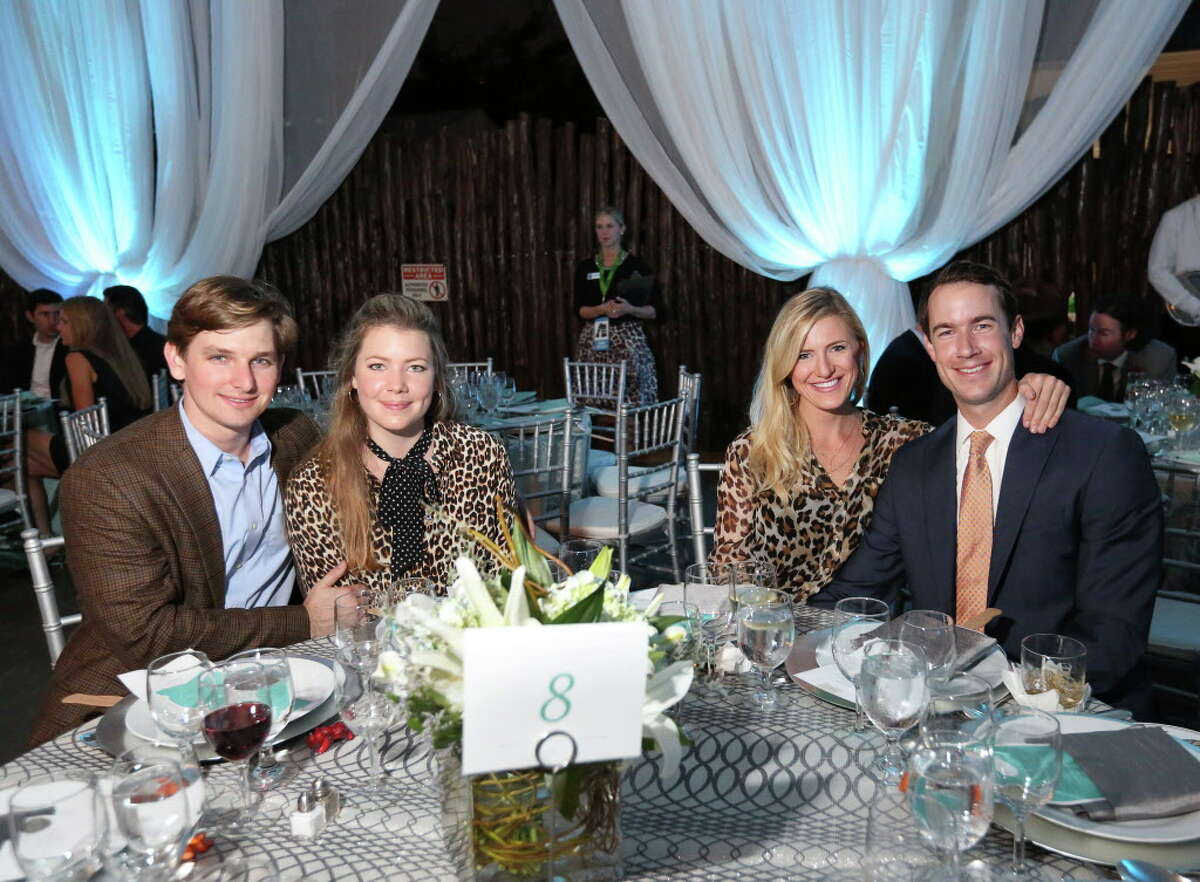 Darren Lindamood, left, Anna McNair, Jourdan Ellis and Holt McNair sit at their table for a photo at Houston Zoo
