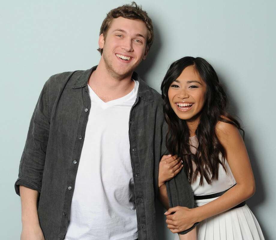 This image provided by FOX-TV shows American Idol finalists Phillip Phillips, left, and Jessica Sanchez taken May 17. The booming 20-year-old vocal powerhouse from Westlake, La., was revealed Thursday to have received the fewest viewer votes on the Fox talent contest, leaving bluesy 21-year-old crooner Phillip Phillips of Leesburg, Ga., and sassy 16-year-old budding diva Jessica Sanchez of San Diego, to compete for the show's record deal grand prize on next week's finale. (AP Photo/Michael Becker, FOX)