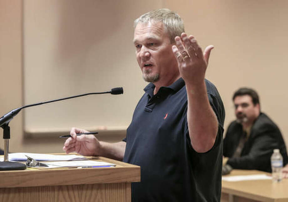 In this Sept. 12, 2016, photo, Brent Clatterbuck, who owns three apartment complexes, speaks during an open comments period at the Bellevue City Council meeting on a proposed measure to ban smoking in apartment buildings. (AP Photo/Nati Harnik)