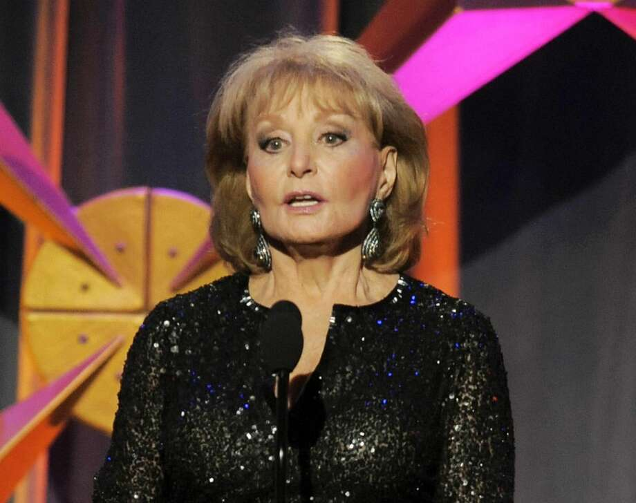 This June 23, 2012 file photo shows Barbara Walters presenting an award onstage at the 39th Annual Daytime Emmy Awards in Beverly Hills, Calif. Walters has the chickenpox and remains hospitalized more than a week after going in after falling and hitting her head at a pre-inaugural party in Washington on Jan. 19. (Photo by Chris Pizzello/Invision/AP, file)