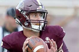 Texas State quarterback Tyler Jones looks to pass during first-half action against the Houston Cougars on Sept. 24, 2016 at Bobcat Stadium in San Marcos.