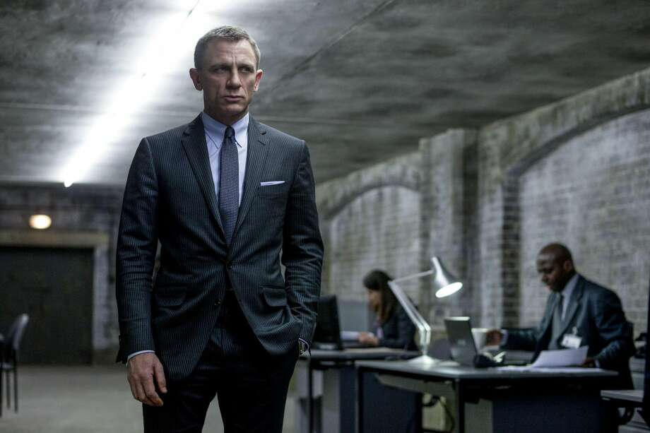 """This film image released by Sony Pictures shows Daniel Craig in a scene from the film """"Skyfall."""" Telecast producers of the 85th Academy Awards say the show will feature a celebration of the 50th anniversary of James Bond. Producers Craig Zadan and Neil Meron announced Friday that the show will pay tribute to the 50th anniversary of the James Bond film franchise, which they describe as """"the longest-running motion picture franchise in history and a beloved global phenomenon."""" The Oscars will be presented Feb. 24 at the Dolby Theatre in Los Angeles. (AP Photo/Sony Pictures, Francois Duhamel)"""