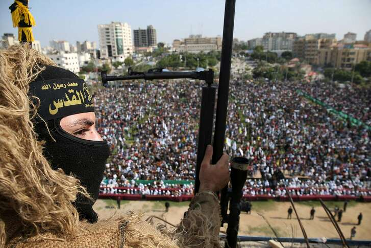 A member of the Islamic Jihad Movement stands guard during a rally to mark the anniversary of the movement's foundation on October 21, 2016 in Gaza City. / AFP PHOTO / MOHAMMED ABEDMOHAMMED ABED/AFP/Getty Images