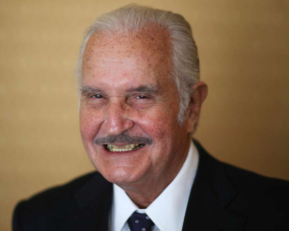 In this March 12 file photo, Mexican author Carlos Fuentes poses for a photo after a press conference in Mexico City. Fuentes, Mexico's most celebrated novelist and among Latin America's most prominent authors, died on May 15, 2012. (AP Photo/Alexandre Meneghini, File)