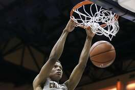Ivan Rabb (1) dunks in the second half as the Cal Bears played the Seattle University Redhawks at Haas Pavilion in Berkeley, Calif., on Tuesday, December 1, 2015. Cal won 66-52.