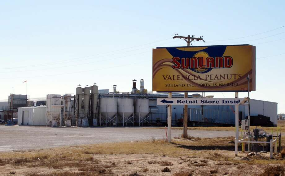 This Nov. 27, 2012 photo shows the Sunland Inc. peanut butter and nut processing plant in eastern New Mexico, near Portales, which has been shuttered since late September due to a salmonella outbreak that sickened dozens. The Food and Drug Administration on Monday, Nov. 26, 2012, suspended the registration of Sunland Inc., which is the country's largest organic peanut butter processor. The company had announced plans to reopen its peanut processing facility on Tuesday after voluntarily shutting down earlier this fall. (AP Photo/Jeri Clausing)