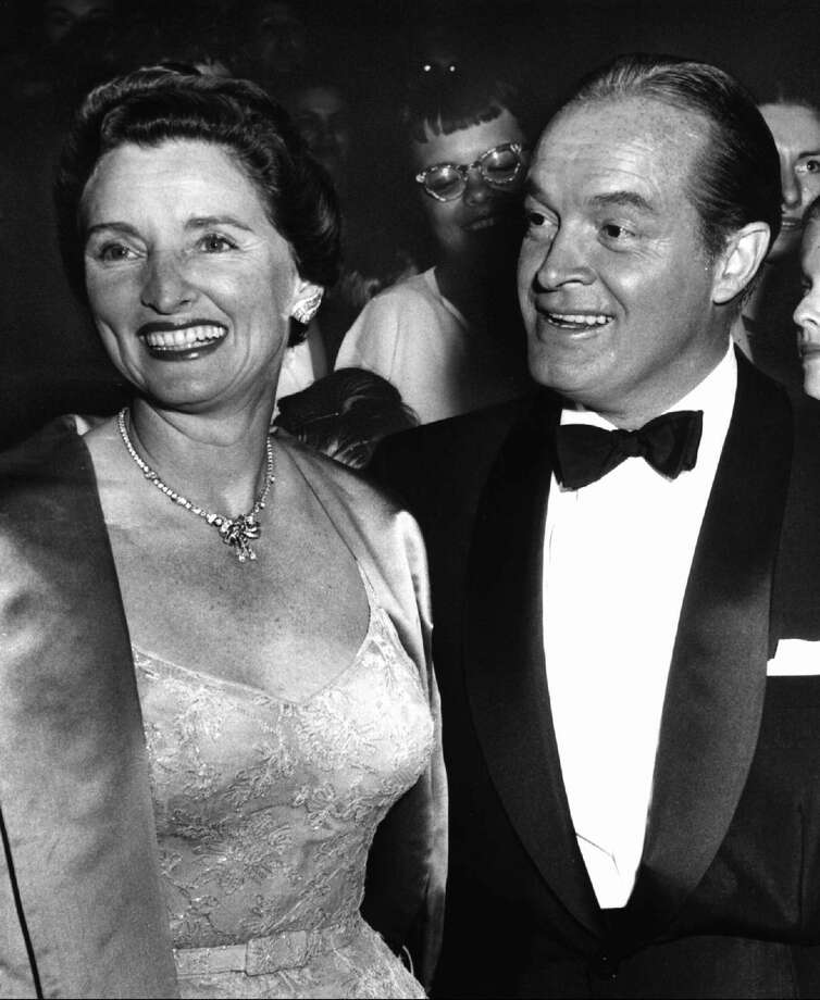 """In this 1955 file photo, entertainer Bob Hope, right, and his wife Dolores attend the premiere of Hope's movie """"The Seven Little Foys"""" at a Paramount Theater in Los Angeles. Dolores Hope, who was married to Bob Hope for 69 years and sang at his shows, died Monday, of natural causes at home in Los Angeles. She was 102. (AP Photo, file)"""