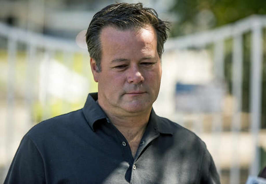 Former NASCAR racer Robby Gordon pauses while making a statement to members of the media gathered outside his home in Orange, Calif., on Thursday, Sept. 15, 2016. Gordon said his family is in shock and grieving the loss of his father and stepmother, who were found dead inside their Southern California home. (AP Photo/Damian Dovarganes)