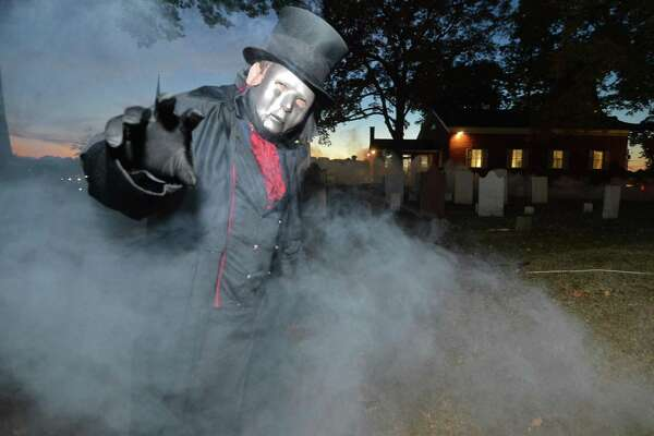 Greg Kaling walks trough the fog in Mill Hill Cemetery as the Phantom on Wednesday October 19, 2016 while they get the Norwalk Historical Society's grounds ready for A Haunting at Mill Hill, this weekend in Norwalk Conn.