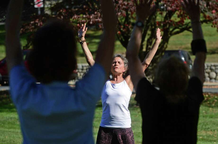 Susan Gold, executive director of the Westport Historical Society and certifield Qi Gong instuctor, leads a 30-minute class in the ancient Chinese practice Wednesday, October 19, 2016 at the Historical Society on Avery Place in Westport, Conn. The classes run from from 12:10-12:45 p.m. through Nov. 16. Photo: Erik Trautmann / Hearst Connecticut Media / Norwalk Hour