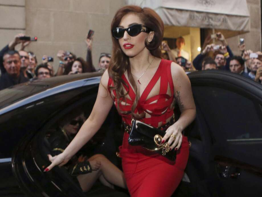 "In this Monday, Oct. 1, 2012 file photo, Lady Gaga arrives at the Versace atelier in Milan, Italy. Lady Gaga is donating $1 million to the Red Cross to aid those affected by Superstorm Sandy. The New York-born singer posted on her blog Wednesday, Nov. 7, 2012 that she is pledging the money on behalf of her parents and sister. She also said she ""would not be the woman or artist that I am today"" if it weren't for places like the Lower Eastside, Harlem, the Bronx and Brooklyn. She writes: ""Thank you for helping me build my spirit. I will now help you rebuild yours."" (AP Photo/Luca Bruno)"