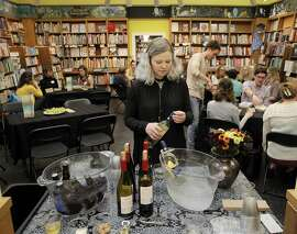 Coley Gold, events manager for Booksmith, prepares drinks during a Book Swap event at Booksmith Book Store in San Francisco, Calif., on Thursday, October 20, 2016. Book stores have seen a decline in business in recent years, forcing some to close, but Booksmith on Haight has not only made a go of it, they are expanding. By becoming a gathering spot for the neighborhood and putting together over 200 events a year, business is steady.