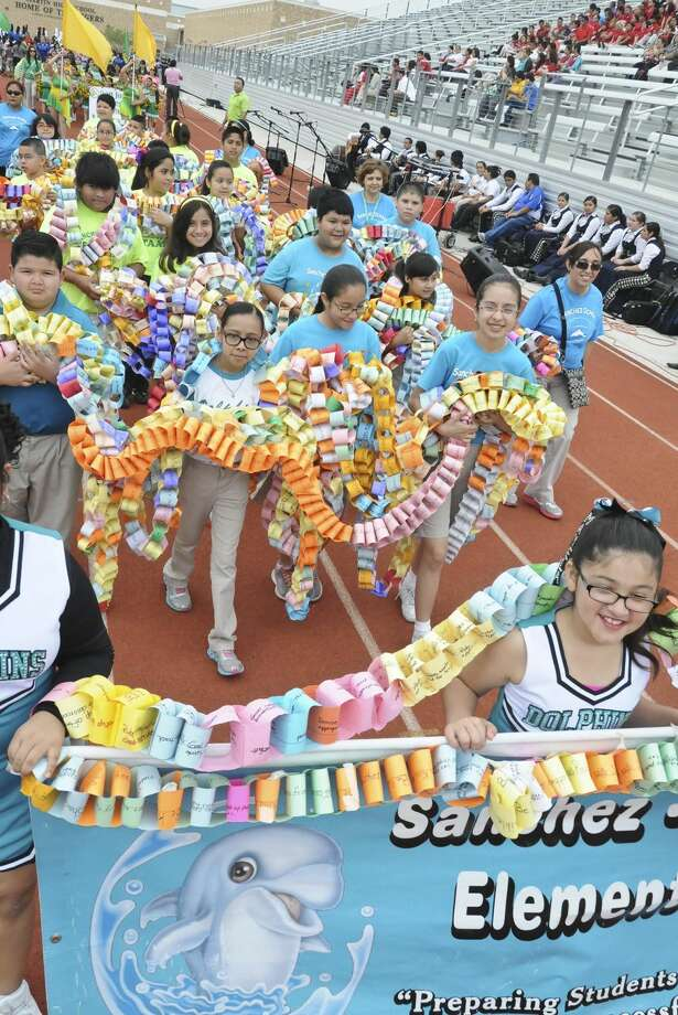 Sanchez Ochoa elementary students participate in a parade carrying paper chain links that symbolize the acts of kindness they did throughout the year as part of Rachel's Challenge Anti Bullying 2nd Rally Thursday morning at Shirley Field. (Photo by: Ulysses S. Romero