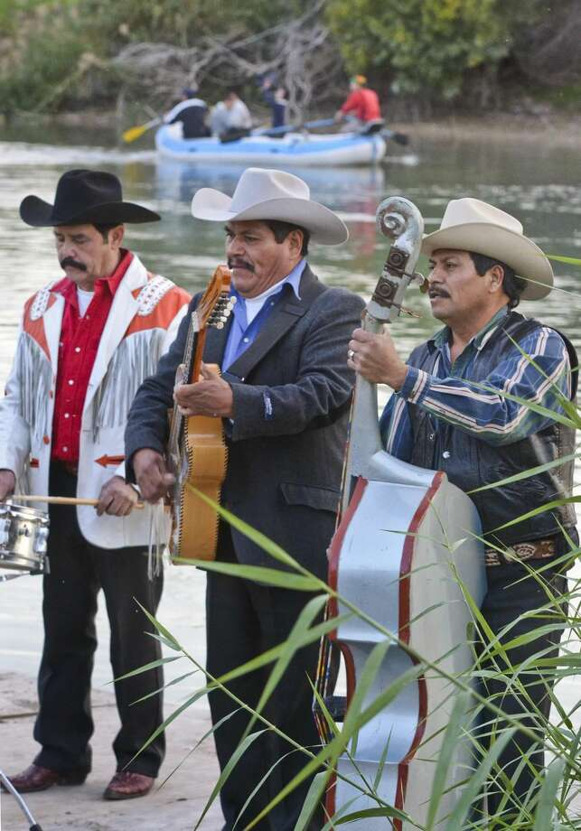 The Mexican Norteño music band, Cielo Norteño, perform during the first ever Posada Norteña as they stand on a barge along the banks of the Rio Grande River last December. (Danny Zaragoza, File/Laredo Morning Times)