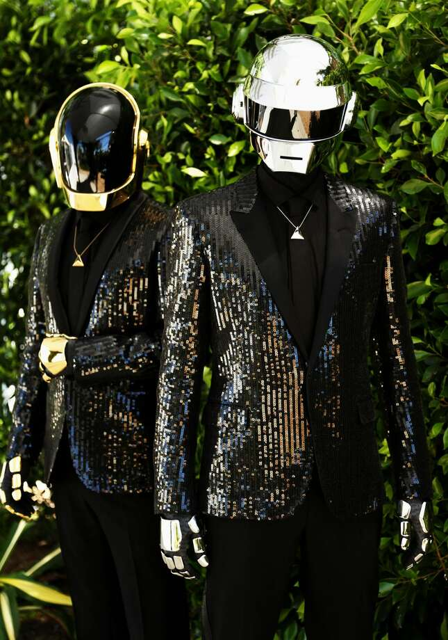 "In this Wednesday, April 17, 2013 photo, Thomas Bangalter, right, and Guy-Manuel de Homem-Christo, from the music group, Daft Punk, pose for a portrait in Los Angeles. The electronic duo's new studio album, ""Random Access Memories"" releases in the US on May 21, 2013. (Photo by Matt Sayles/Invision/AP)"