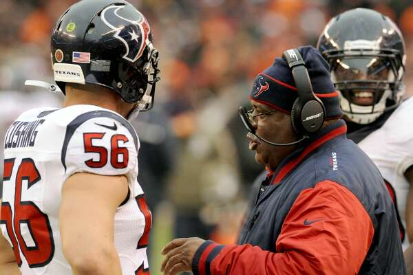 CLEVELAND, OH - NOVEMBER 16, 2014: Defensive coordinator Romeo Crennel of the Houston Texans talks with linebacker Brian Cushing #56 on the sideline during a game against the Cleveland Browns on November 16, 2014 at FirstEnergy Stadium in Cleveland, Ohio. Houston won 23-7. (Photo by Nick Cammett/Diamond Images/Getty Images)