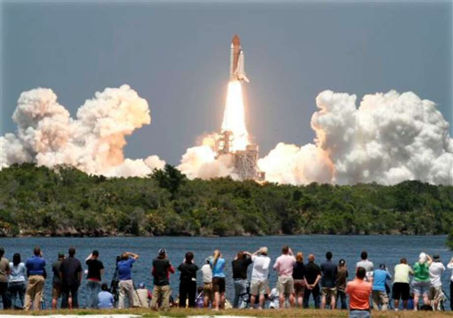 Space shuttle Atlantis lifts-off from the Kennedy Space Center at Cape Canaveral, Fla. Friday May 14, 2010. Atlantis' 12-day mission will deliver a Russian built storage and docking module to the International Space Station. (AP Photo/Marta Lavandier) Photo: Marta Lavandier, AP / AP2010
