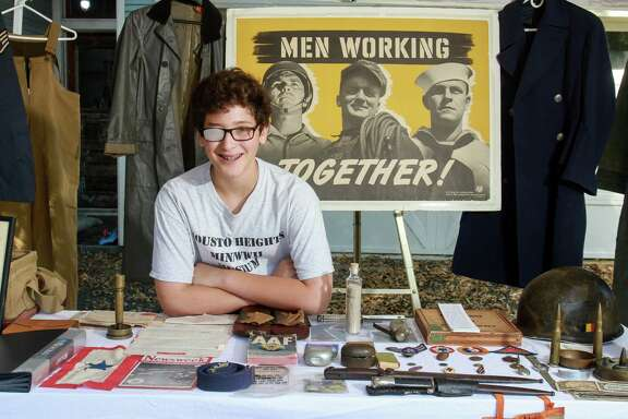Fourteen-year-old Jake Cosgrove with his private museum of World War II memorabilia. His interest has generated intense study and the drive to meet veterans of the nation's last popular war. Every other Saturday he exhibits his private museum in the driveway of his parents' Houston Heights home.   (For the Chronicle/Gary Fountain, October 15, 2016)