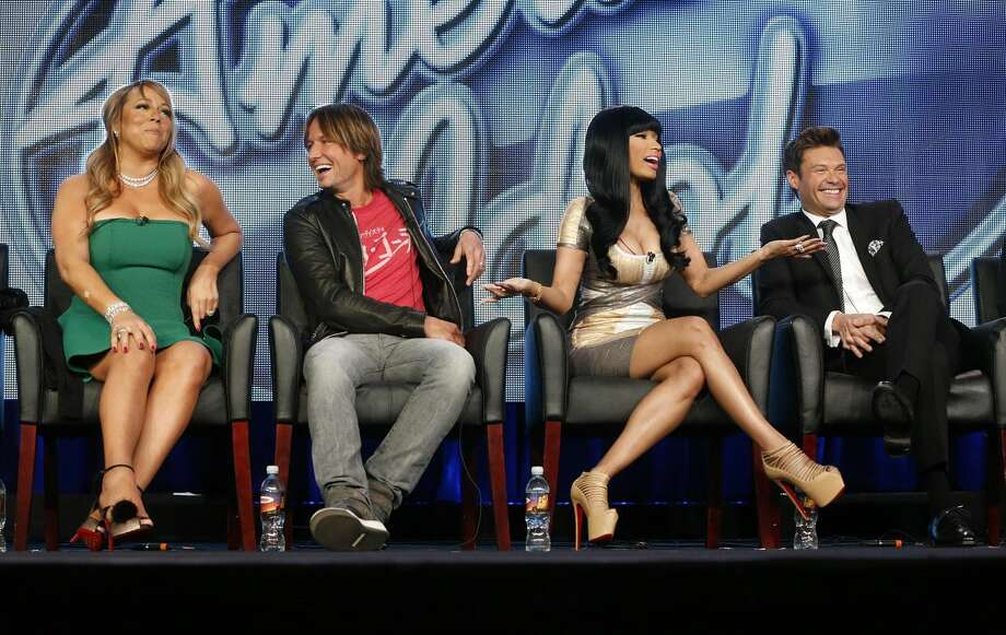 "In this Tuesday, Jan. 8, 2013 photo, from left, Mariah Carey, Keith Urban, Nicki Minaj and Ryan Seacrest from ""American Idol"" attend the Fox Winter TCA Tour at the Langham Huntington Hotel, in Pasadena, Calif. ""American Idol"" returns on Wednesday, Jan. 16, 2013, for Season 12 on FOX. (Photo by Todd Williamson/Invision/AP, File)"