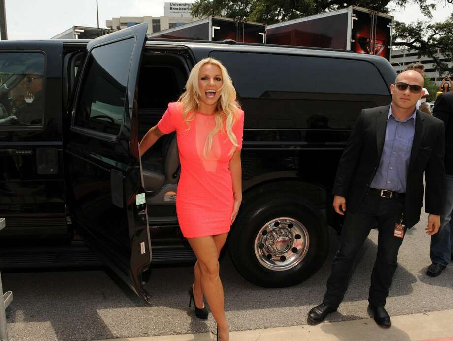 "In this photo released Thursday by Fox, singer Britney Spears arrives at the taping of ""The X-Factor,"" in Austin. Spears will be a judge on the second season of the singing competition series. (AP Photo/Fox, Frank Micelotta)"