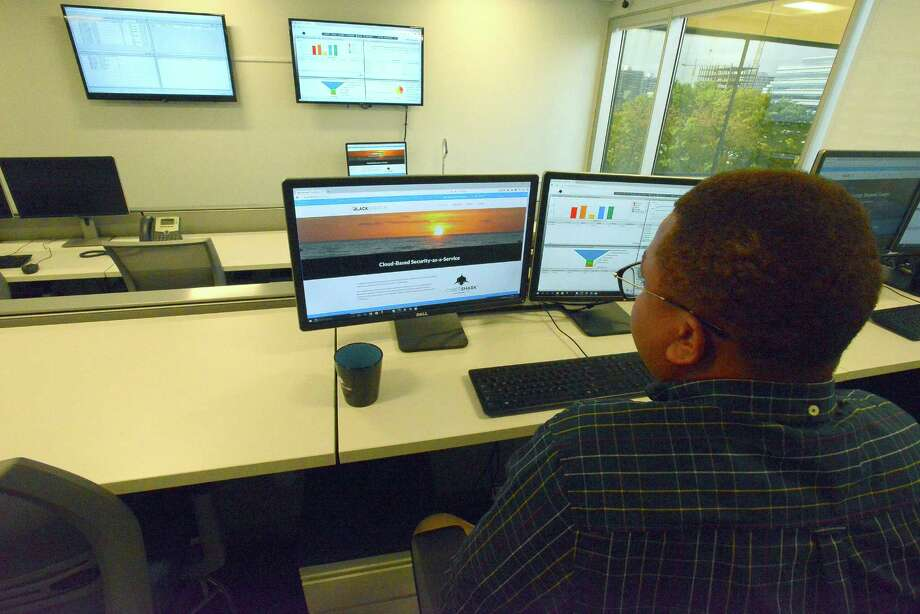 Jereel Udom, a security analyst with Cybershark of BlackStratus logs into a secure portal in the Security Operations Center (SOC) at their Stamford based offices on Thurday, Oct. 20, 2016. Photo: Cathy Zuraw, Hearst Connecticut Media / Stamford Advocate