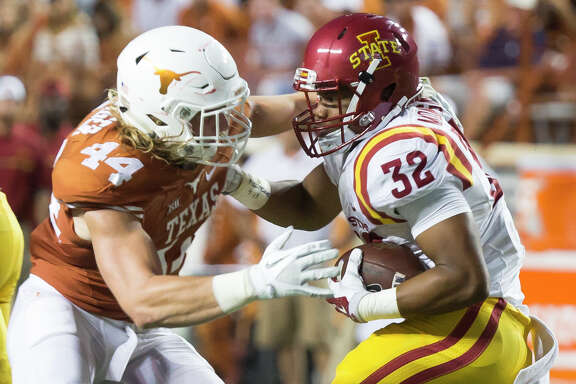 Texas' Breckyn Hager (44) tries to bring down Iowa State running back David Montgomery (32) during the first half on Saturday, Oct. 15, 2016, at Darrell K. Royal-Texas Memorial Stadium/Jamail Field, in Austin, Texas. (Ricardo Brazziell/Austin American-Statesman/TNS)