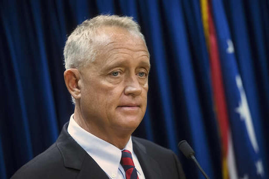 FILE - In this July 29, 2015, file photo, Hamilton County Prosecutor Joe Deters speaks during a news conference in Cincinnati. After a surge in overdoses in the Cincinnati area, Hamilton County Prosecutor Joe Deters, the county sheriff, coroner and other officials went to court Wednesday, Sept. 7, 2016, seeking immunity from prosecution to anyone who turns in heroin or other potentially deadly drugs. Hamilton County Common Pleas Judge Robert Ruehlman agreed. (AP Photo/John Minchillo, File)