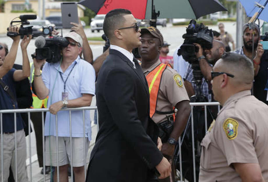 Miami Marlins right fielder Giancarlo Stanton arrives for a memorial service for Miami Marlins pitcher Jose Fernandez, at St. Brendan's Catholic Church, Thursday, Sept. 29, 2016, in Miami. Fernandez was killed in a boating accident Sunday along with two friends. (AP Photo/Lynne Sladky)