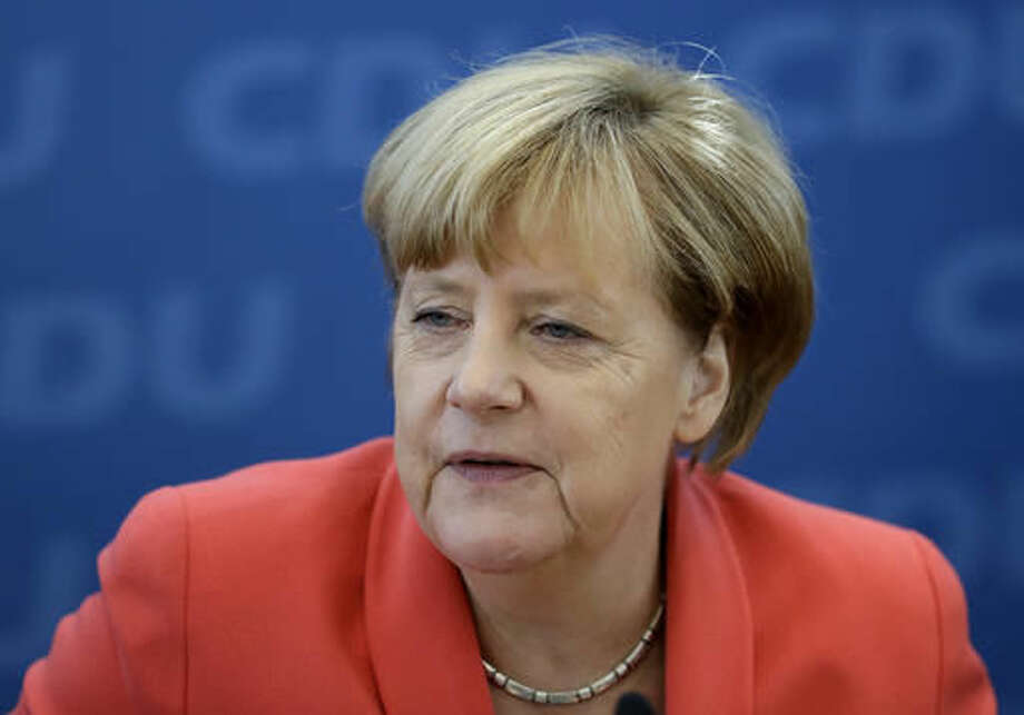 German Chancellor Angela Merkel waits for the beginning of a board meeting of the Christian Democratic party CDU in Berlin, Germany, Monday, Sept. 19, 2016, the day after Merkel's party endured a second setback in a state election in two weeks, as many voters turned to the left and right in Berlin. (AP Photo/Michael Sohn)