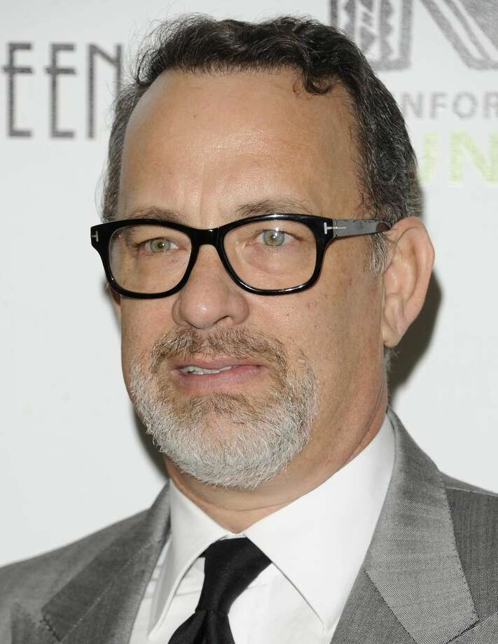 In this April, 3 ,2012 file photo actor Tom Hanks attends the Revlon Concert for the Rainforest Fund dinner in New York. A Southern California insurance broker was arrested Wednesday, Nov. 7, 2012, on allegations he overcharged Hanks, musician Andy Summers and others hundreds of thousands of dollars for insurance premiums. (AP Photo/Evan Agostini, File)