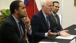 U.S. Sen. John Cornyn (center) speaks recently at the downtown U.T.S.A. campus about programs to employ veterans in the law enforcement field. Seated on the left is U.S. Rep. Will Hurd and on the right is George P. Bush, Texas General Land Commissioner.