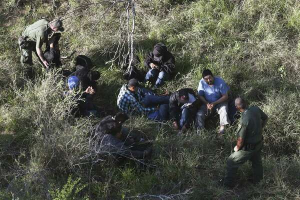 Border Patrol agents capture a group illegal immigrant hiding in brush on a ranch northeast of Rio Grande City, Texas. A reader says it is important to remember that undocumented immigrants are part of the economic and cultural fabric of our nation.