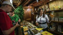 German tourists purchase cigars at a shop in Havana. President Barack Obama on Oct. 14 made what aides said were likely his final major modifications to loosen United States sanctions on Cuba before leaving office, including lifting the $100 limit on bringing Cuban rum and cigars into the United States.