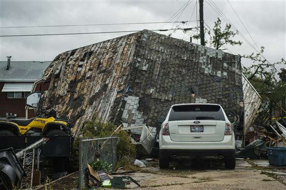 A structure is damaged caused from a tornado in Washington Terrace City, Utah, Thursday, Sept. 22, 2016. Other storms in the area that produced winds in excess of 70 mph caused damage to trees and other property near the city of Layton. That's about 15 miles south of Washington Terrace. (Chris Detrick/The Salt Lake Tribune via AP)