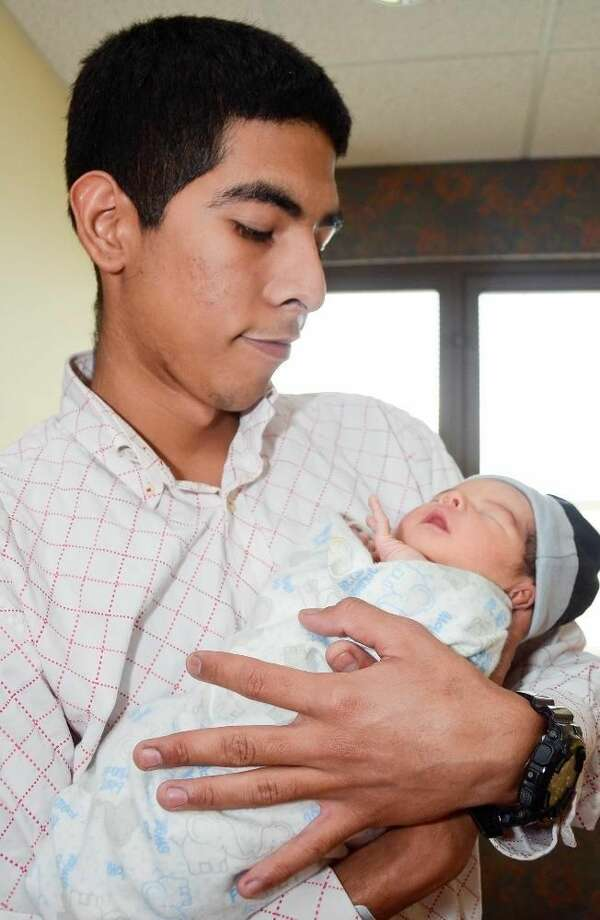 Cristian Ignacio Aguilar holds his newborn son, Cristian Ignacio Aguilar Jr., at Laredo Medical Center on Sunday afternoon. Find out more in Monday's newspaper and e-Edition. Photo by Danny Zaragoza
