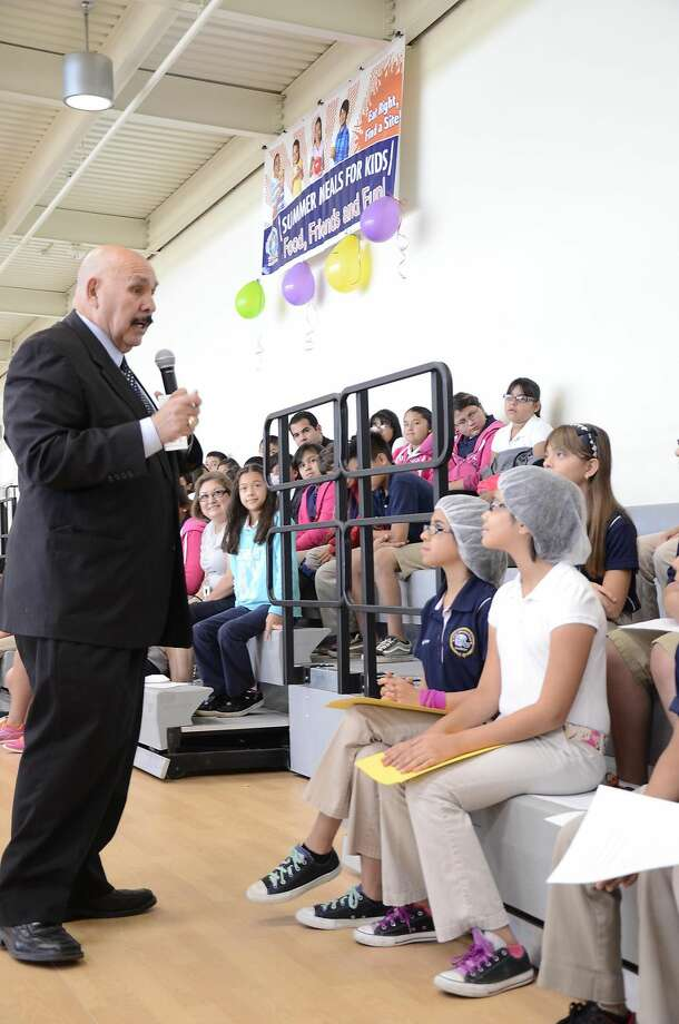 Mayor Raul Salinas speaks to UISD students and teachers during the kickoff for the district's Summer Meals for Kids nutrition program Tuesday morning at the Haynes Recreation Center. Children from 1 to 18 are eligible for the program, which is offered at several sites around town, without registration. (Cuate Santos/Laredo Morning Times)